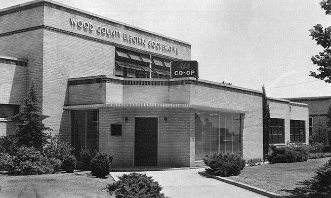 A black and white photo of the Historic Wood Count Electric Cooperative building