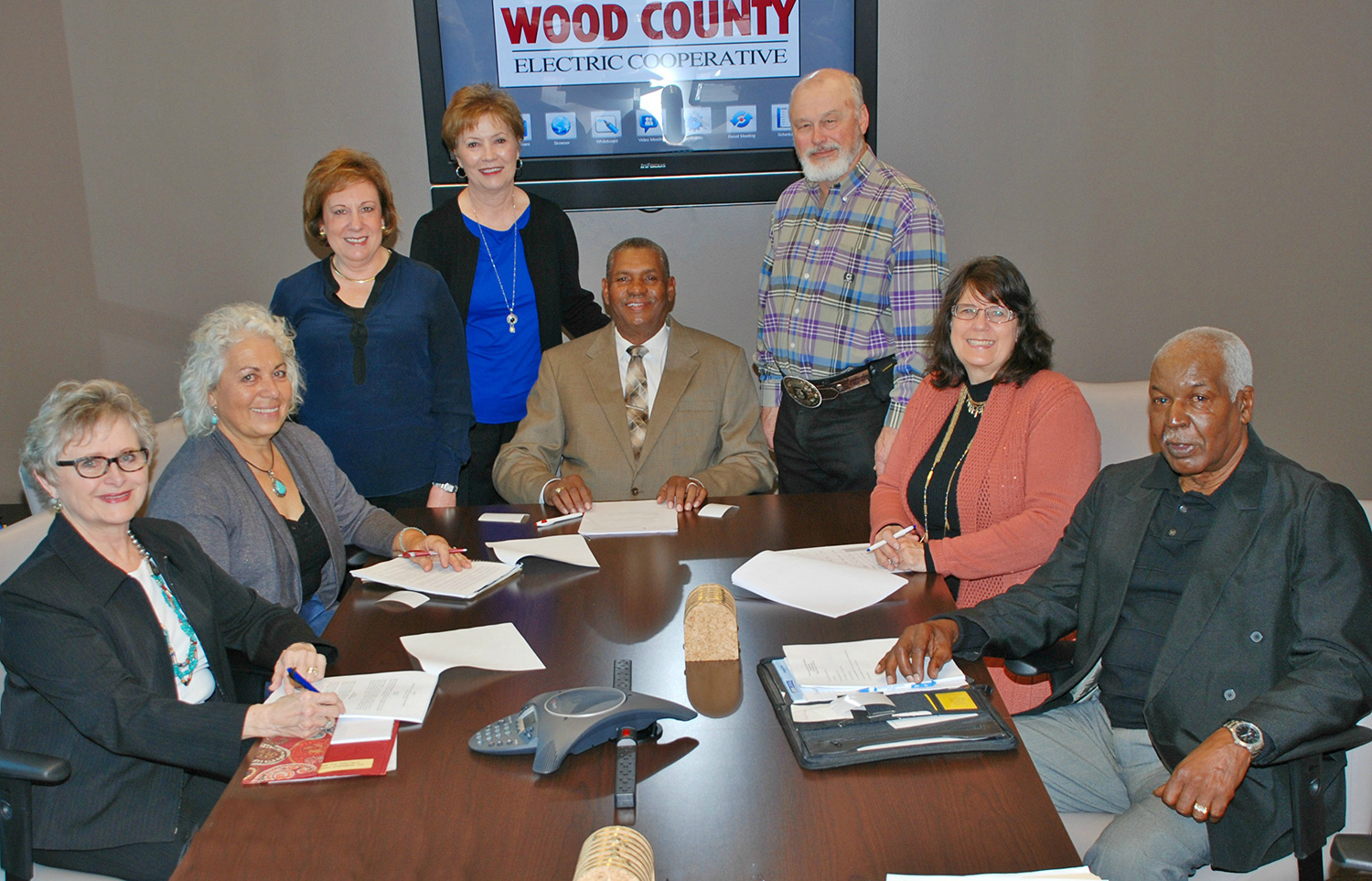 The Wood County Electric Charitable Foundation board members sit in a meeting around a conference table.